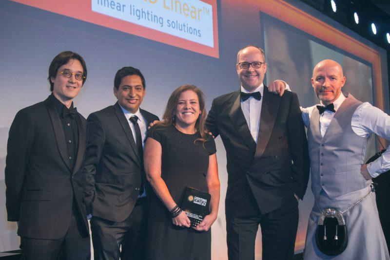 """Nicholas Cheung, César Castro and Claudia Paz receiving the Lighting Design Awards for """"Affinity""""."""